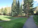 Beautifully landscaped, Homestead is one of the loveliest HOAs in all of Keystone. Path to condo.