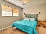 This bedroom also offers a queen bed.