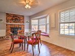 The red brick-mounted wood-burning fireplace creates a peaceful ambiance in the dining room.