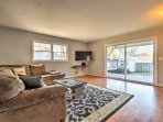 Inside, the home features hardwood floors, tasteful decor, and comfortable furnishings.