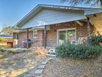 The 3BR/2BA home features a fenced-in backyard with a covered porch so your furry friends can run around while you're...
