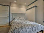 You and your loved one can cuddle all night in this queen bed.