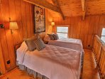 A cozy loft sleeps 2 in 2 twin beds.