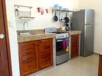 Fully equipped kitchen includes cooking utensils, cutlery and dining ware for up to 4 guests