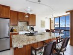 The fully equipped kitchen was recently updated with granite countertops and stainless steel appliances.
