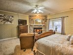 The master bedroom is complete with a plush king bed and private fireplace.