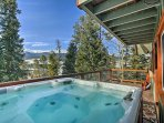 Soak up the Rocky Mountains from the soothing hot tub!