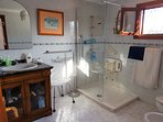 Front en-suite with long shower base  glass panel shower stool, safety hand rails, toilet rail