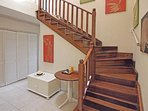 Mahogany stairs to the upper floor