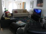 2 leather couches and leather chair, cable tv