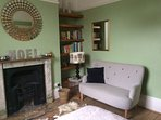 Bedroom 2 - lovely double bed, sofa, books and garden view