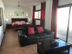 Bay View Villa - Master Suite with Super Kingsize Bed, Leather Sofa and Coffee Table in front of TV