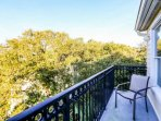 Take in the blue skies and ocean breezes from the third floor balcony off the master bedroom.