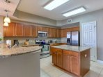 Pack a lunch for the family or enjoy whipping up a an amazing meal in this Beautiful Kitchen with Granite Counter tops...