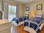Let the kids wind down and enjoy the twin beds in this cozy guest bedroom with its own entrance to guest bathroom.