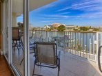 Enjoy a Cocktail while watching the Dolphins and Gorgeous Sunset on this lovely Bay Front Patio