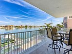 Enjoy a Cocktail or an Alfresco Meal while watching the Dolphins on this Lovely Bay Front Patio