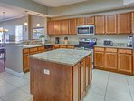 Entertain while Whipping that Amazing meal up in this Spacious Kitchen with Granite Counter tops and Stainless Steel...