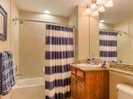 Lovely Guest Bathroom with Granite Counter tops, Shower and Tub