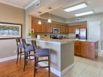 Spacious Kitchen with Granite Counter tops, Stainless Steel Appliances, Breakfast Bar off Dining Area