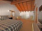 Master bedroom, king size bed, TV, and desk