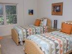 'orange' twin room as twin beds