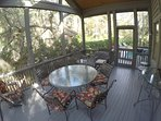inside the screened porch, large 60' table, chairs, rockers!