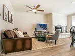 Enjoy the wood burning fireplace or flat screen TV in the open layout of the home.