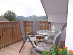 A large balcony with garden furniture and nice views.