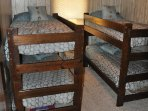Bedroom 4: Double Bunk Beds ( Guard Rails and Crib Mattress with Linens Available )