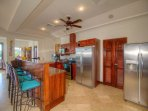 Two over-sized refrigerators serve a full house