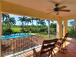 Enjoy a shady view of the garden and pool