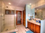 Spacious bath with wooden cabinets and doors