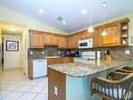 Large kitchen with granite counter tops, dishwasher, stove/oven/microwave and fully stocked