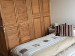 Twin bedroom with built in wardrobe . Overlooks garden