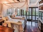 A room reminiscent of old travel adventurers. Twin or Queen beds with beautiful garden & sea views