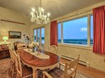 Share formal meals around this lovely dining table with water views.