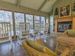 Lounge in this shared great room overlooking the enchanting estate.