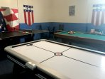 Games room with foosball, air-hockey, pool table and ping-pong