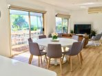 Open plan kitchen, dining and living area with ocean views