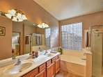 Rinse off in the master en-suite with a garden tub and separate shower.