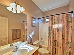 A shower/tub combo can be found in the third bathroom.