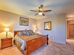 Retreat to the master bedroom to rest your head on the king bed.