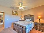 Lay back on the queen bed in the third bedroom.
