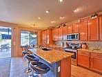 Sit at the breakfast bar and see what's cooking in the fully equipped kitchen.