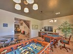 Play foosball, poker, or watch the flat-screen cable TV in the game room.