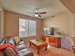 Escape for some alone time in the den with a leather couch and flat-screen TV.
