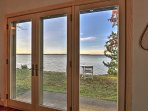 Floor-to-ceiling windows provide incredibly scenic lake views from the family room!