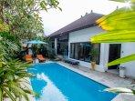 Pool sorrounding by tropical garden