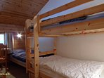 Bedroom with 3 beds whom 1 bunk beds